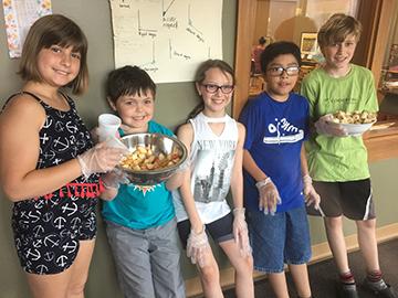 Upper Elementary children serving fruit