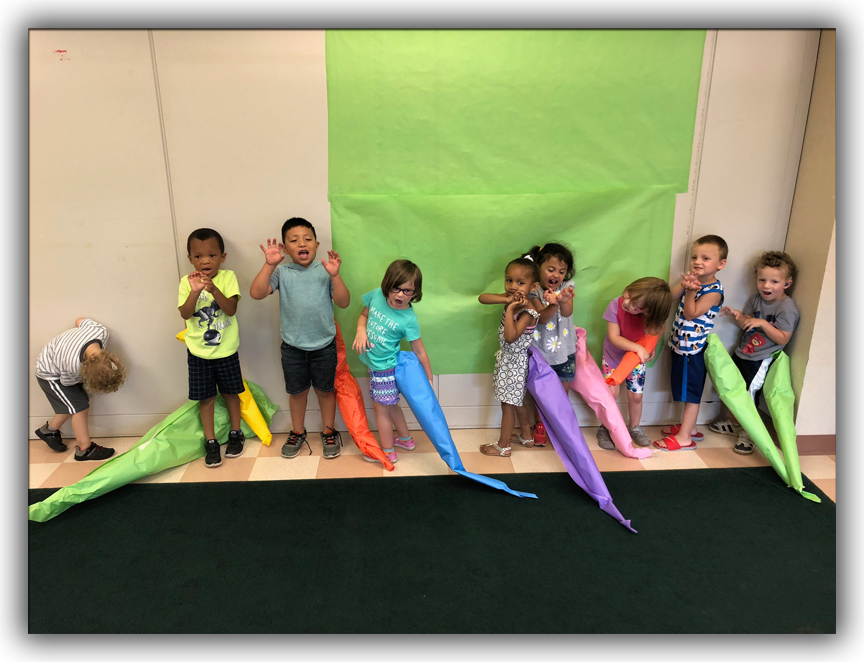 Picture of Early Childhood students standing by the wall