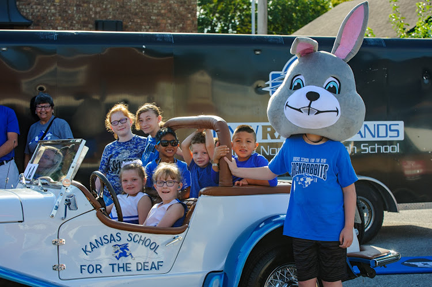 Jackrabbit and all KSD students are sitting in the KSD Antique car.