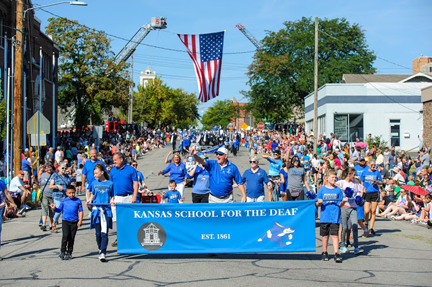KSD staff, students and parents are participating to march and to wave down the street.