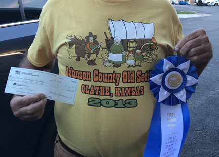 KSD was voted for the best vintage car and was awarded a monetary prize as well as a big blue ribbon.