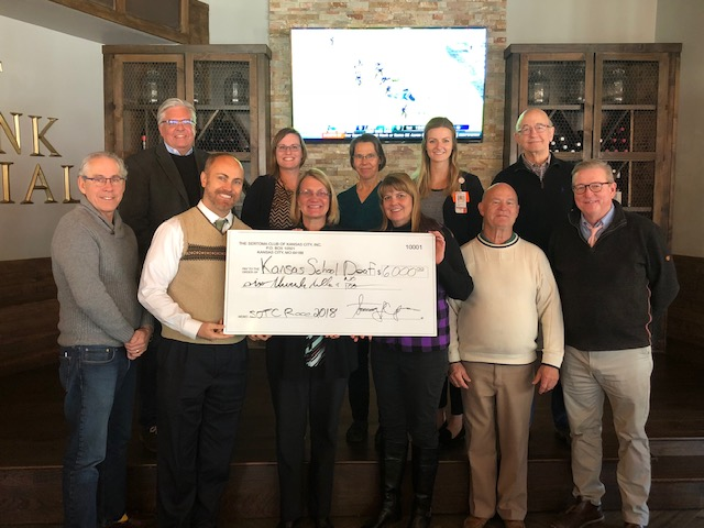 Picture of a group with a check for $6,000
