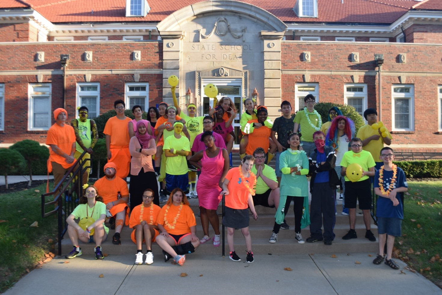Students showing their homecoming spirit - Sept 18, 2019 - the Neon Day in the front of Roth building.