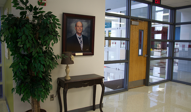 inside of the main office with school's namesake picture-Russell P. Schupmann