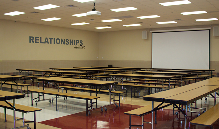 """cafeteria area with motto """"Relationships Matter"""""""