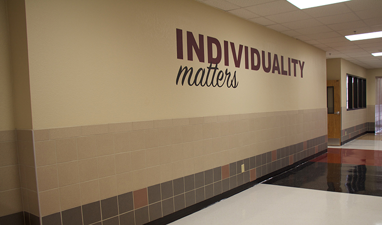 """hallway with motto """"individuality matters"""""""