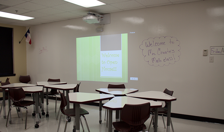 typical classroom with new projectors and entire white-board dry erase wall