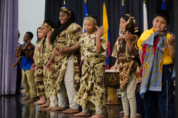 Students peforming an African dance accompanied by drumming!
