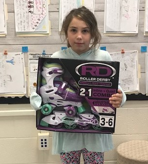 student with prize skates