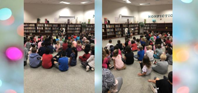 Second graders listening to a read aloud by Dr. Hillary Spangler.
