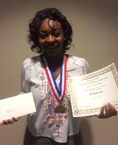 student receiveing scholarship award