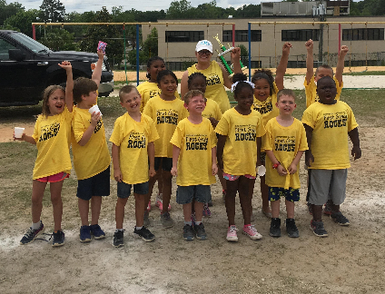 Mrs. McLane's first grade class with their Field Day trophy