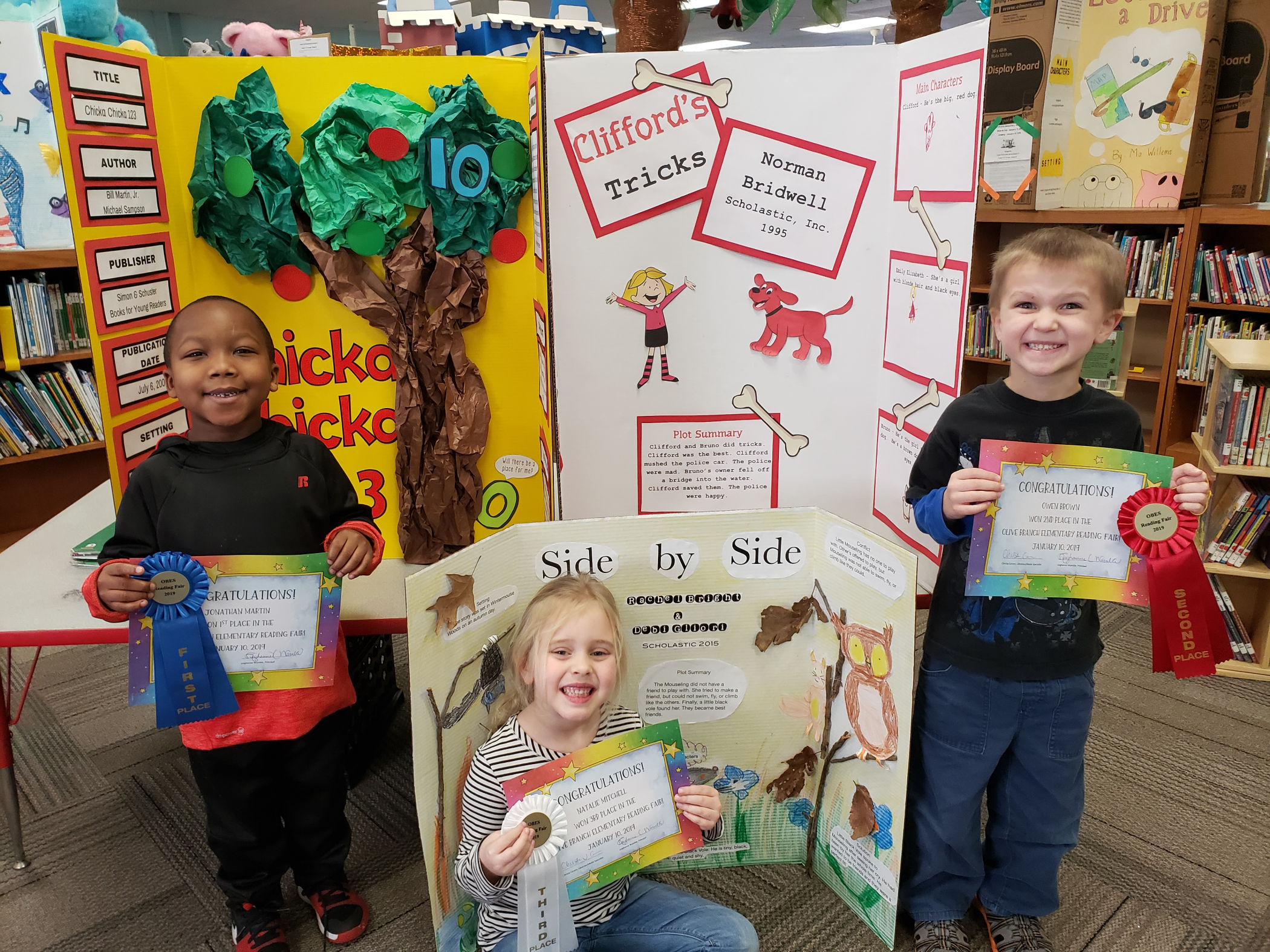 Pictures of students that won the reading fair
