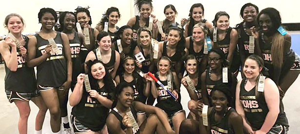 Cheerleading team showing competition ribbons