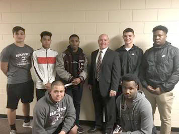Head Coach Ross with 5 members of football team