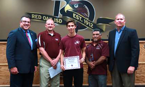 Zach with administrators, coach, and board member