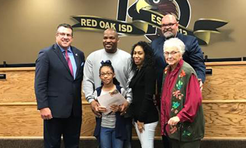 Jasmine Smith with family, adminstrators, and board member