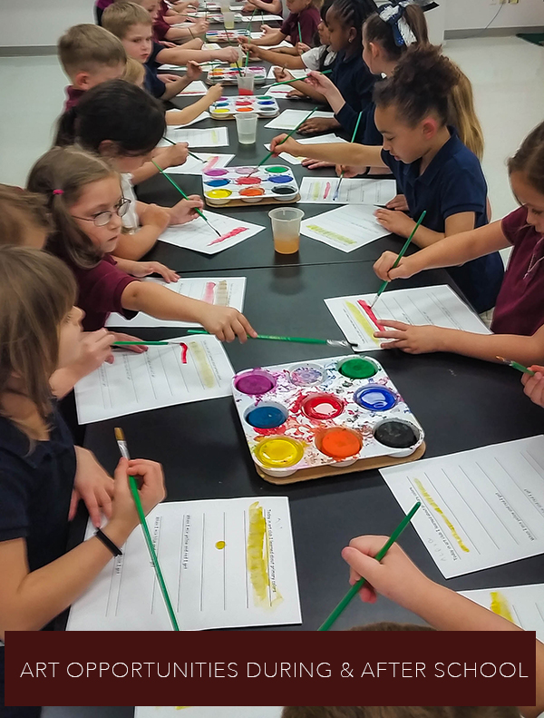 elementary students painting during art classroom