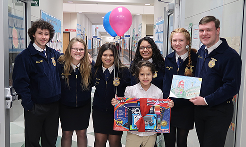 FFA poster contest winner, Ambar Mackey, with FFA officers