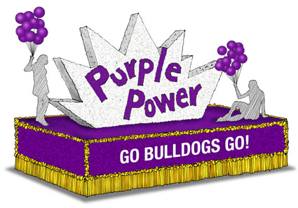 This is an image of a purple and gold homecoming float.  The float says Purple Power and Go Bulldogs!  The float has two people standing on it.  Each person is holding a bunch of purple balloons.