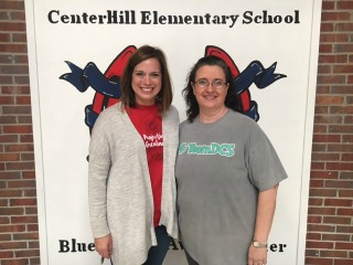 Picture of teachers Mrs. White and Mrs. Harris standing infront of a door.