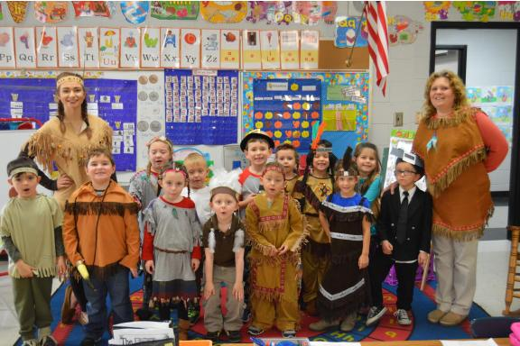 Kindergarteners dressed up for Thanksgiving