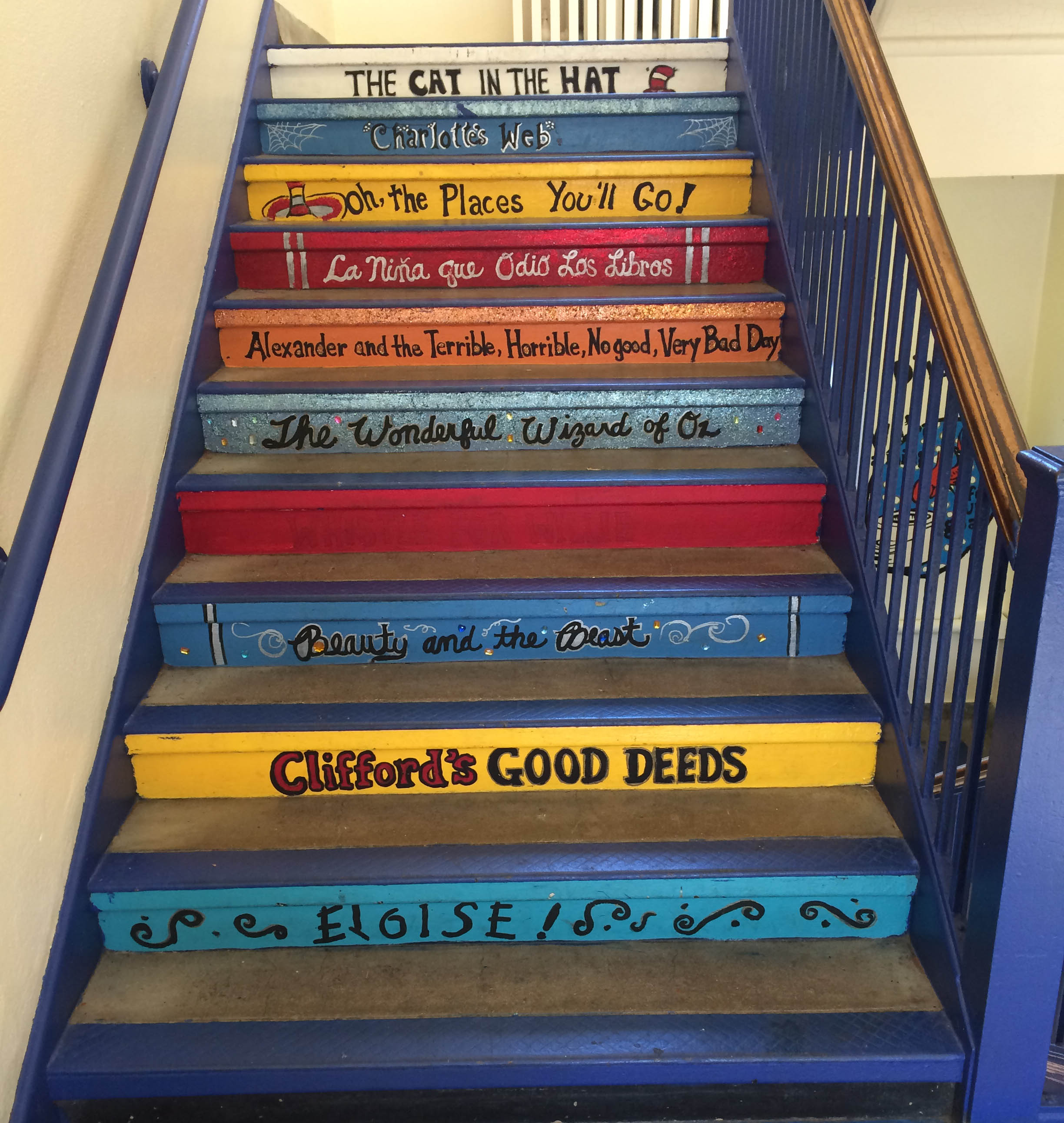 stairs with book titles