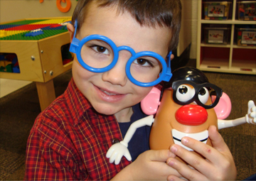 Child playing with Mr. Potato Head