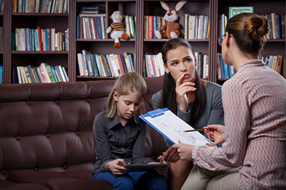 parent and adult speaking in library