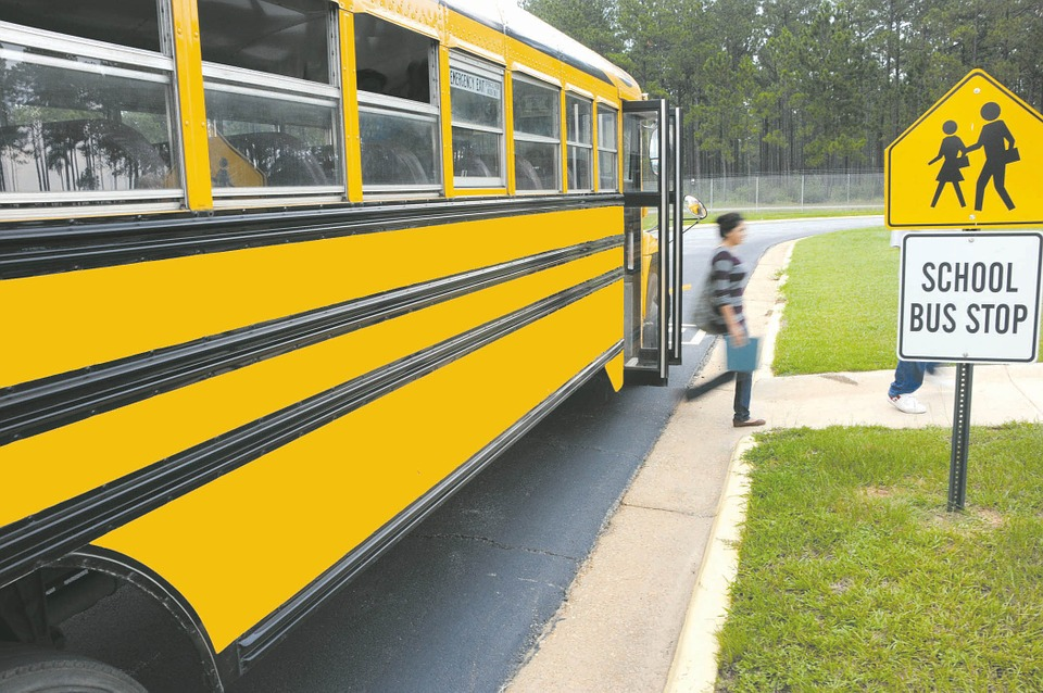 School bus dropping off student