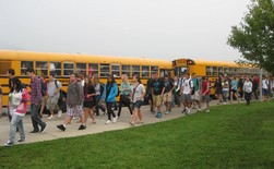Children walking up to their busses