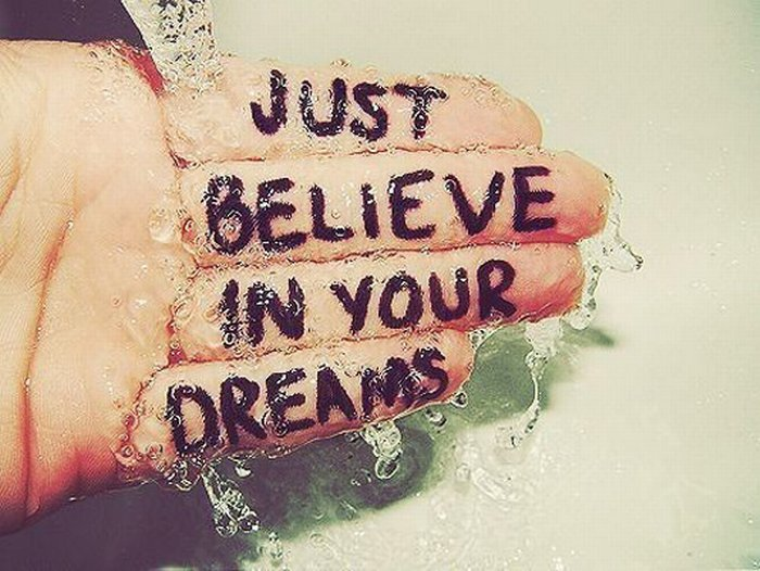 hand in water with word written on hand - Just believe in your dreams