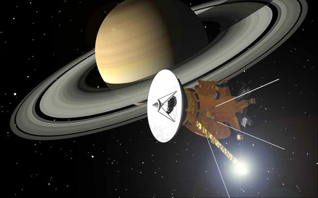 the planet Saturn with the Cassini satellite in front of it