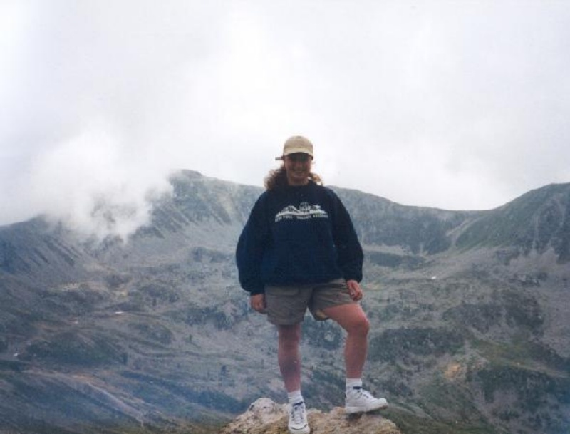 Mrs. Simons standing on a mountain in the Alps