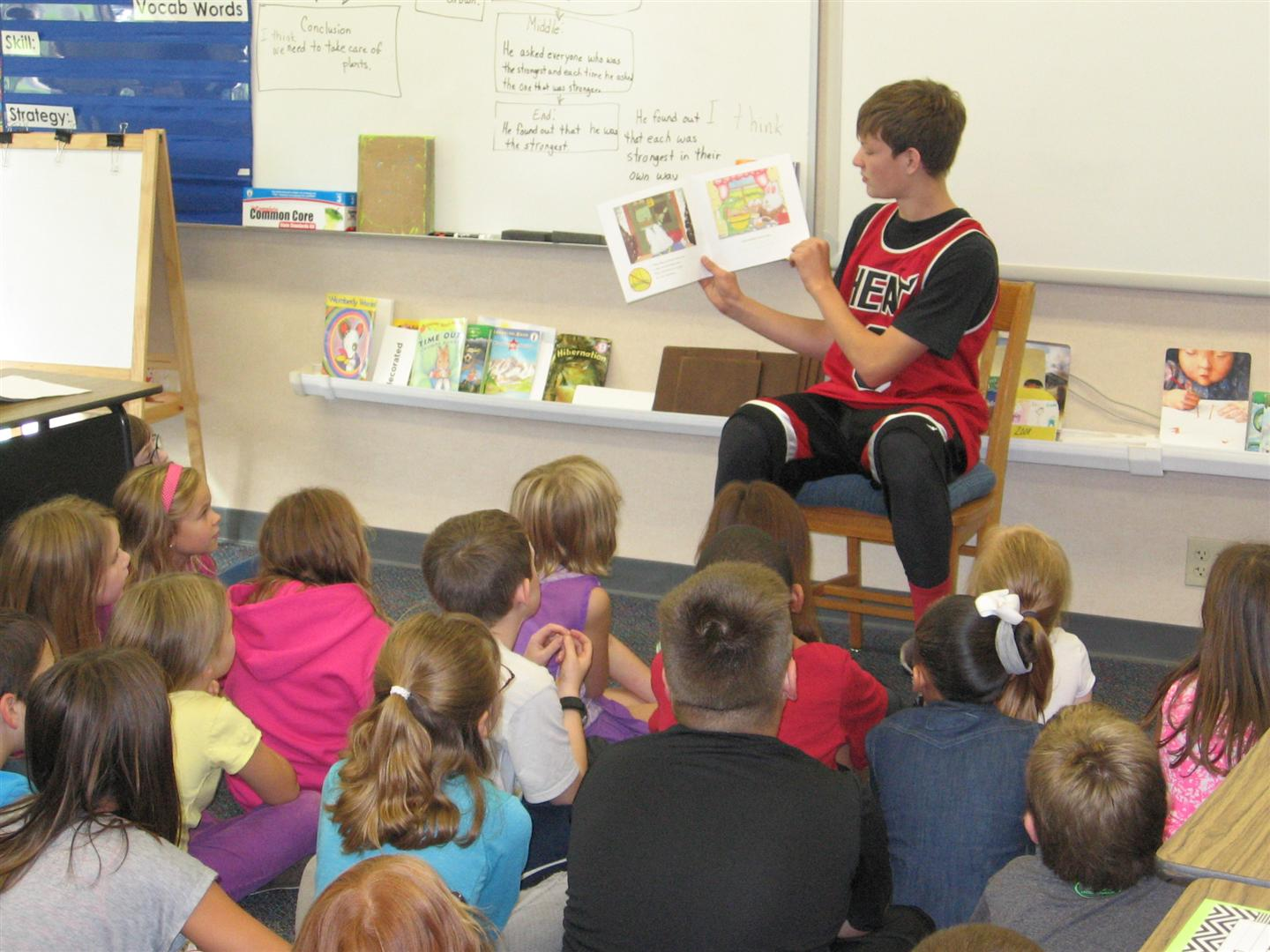 Student Reading at Assembly