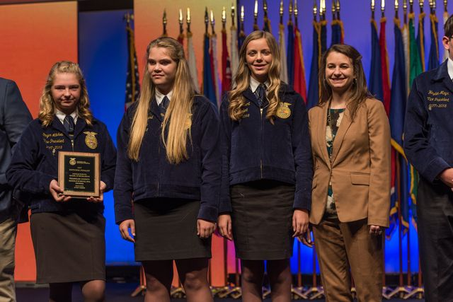 Middle School Models of Excellence Ginger Mitchell, Gracie Minyard, Abbie Gilbert and Advisor Anna Watkins were recognized on stage