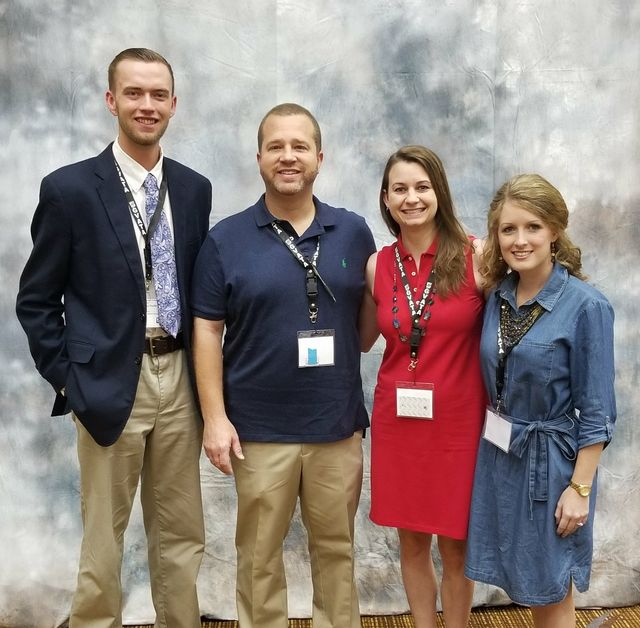 First year teachers Brandon Poole and Addie Tucker are pictures with two of their former agriculture teachers Cale Watkins and Anna Watkins