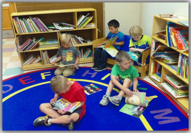 Picture of Early Childhood students reading books