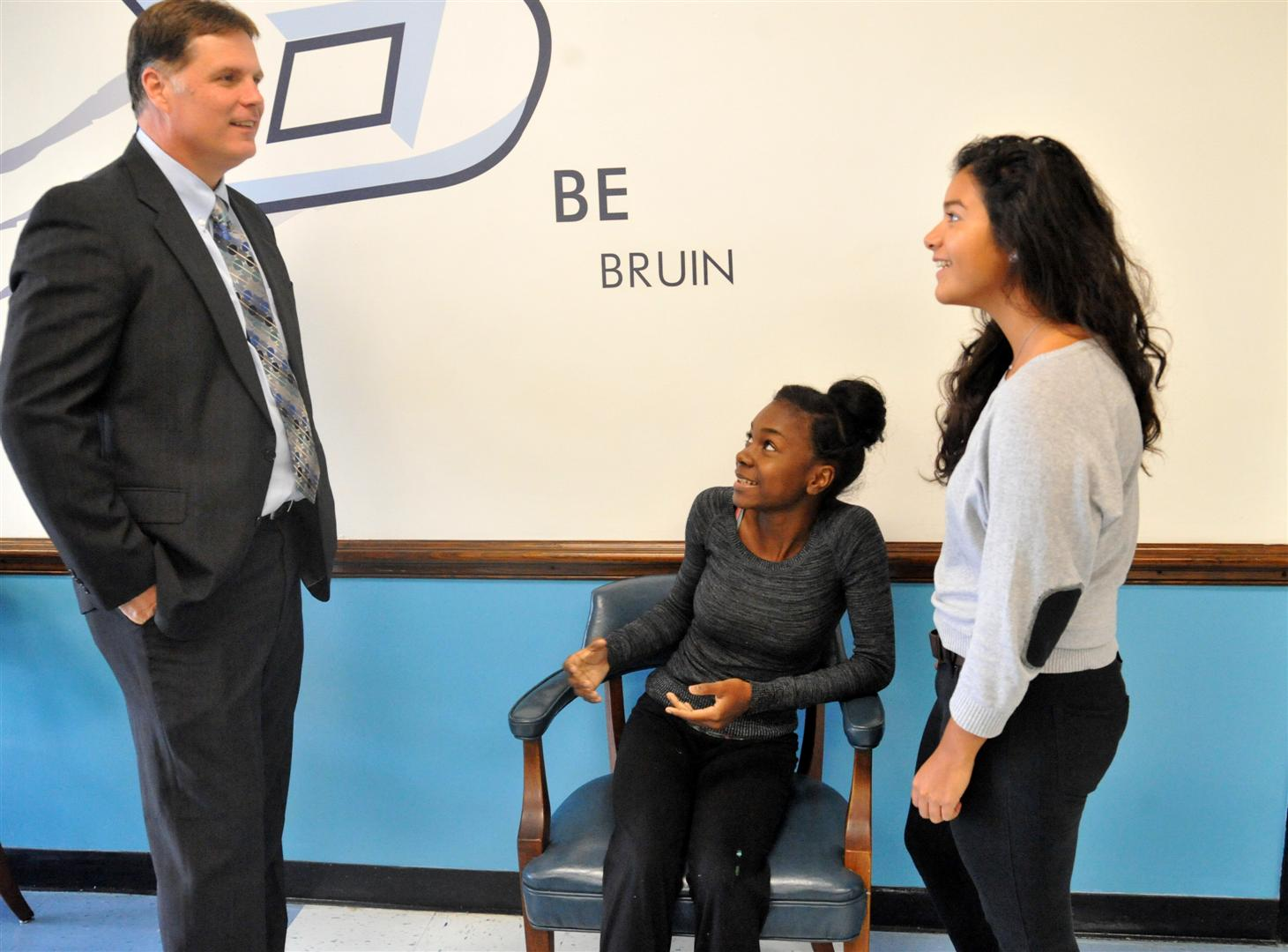 Mr. Franks talks with Martina and Elizabeth
