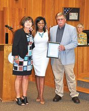 Kelly receiving awareness proclamation from Mayor of Sylacauga