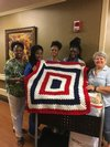Deborah Cain with volunteers and Mary Evans during visit to the Tuscaloosa VA Nursing Home (click for larger image)