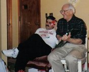 Louis N. Muro (right) is shown here with his son Ronnie. Mr. Muro's idea to form a Knights of Columbus Council at St. Patrick Catholic Church in Adamsville became reality on March 17, 1991 when 62 men became First Degree Knights.